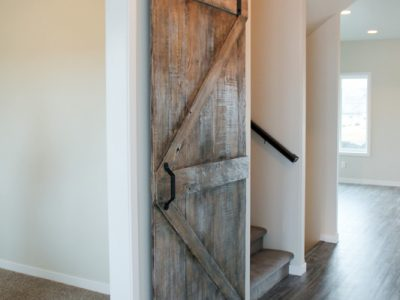 Main Entry Office Den Sliding Barn Door in Jordahl Custom Homes Fargo - Dark Walnut Glaze Finish