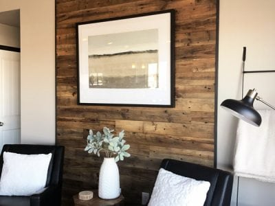Reclaimed Brown Board Paneling with Black Metal Angle Iron Trim