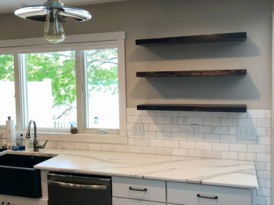 Dark Wood Floating Kitchen Shelves and White Subway Tile Farmhouse Kitchen